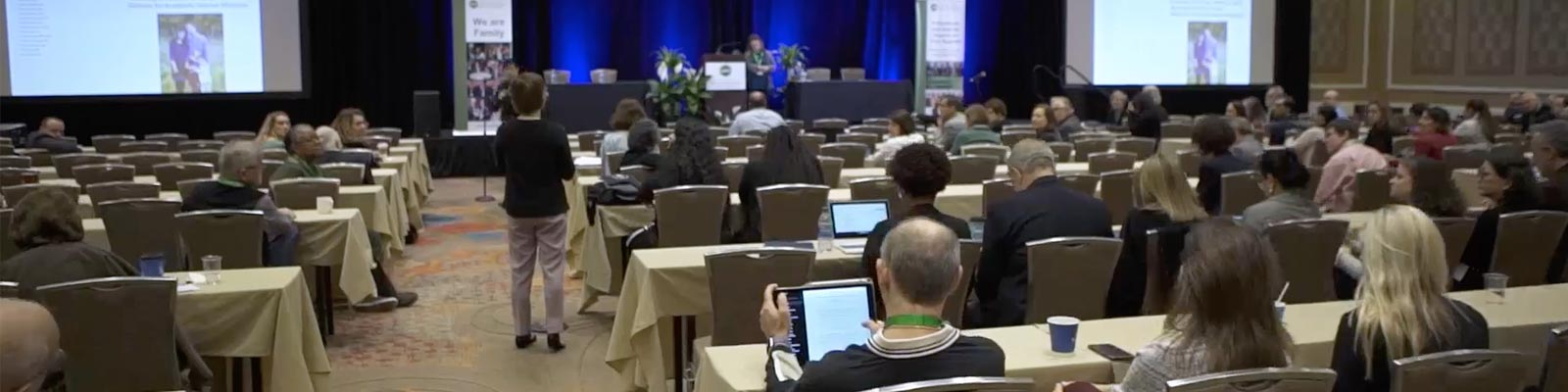 People attend a conference in a large hall